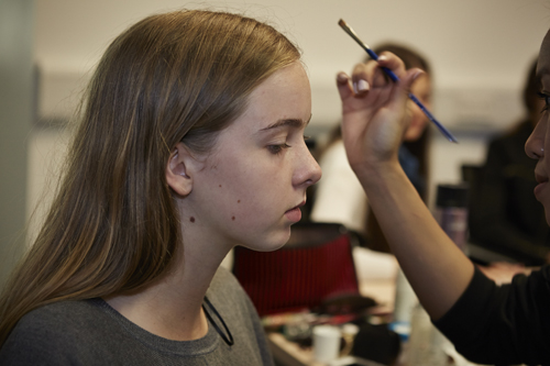A model gets ready for the catwalk backstage